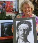 Facilitator, Jan Cross, with participants' work in Extraordinary Mind Project's drawing class with a 'brain-aware' difference!