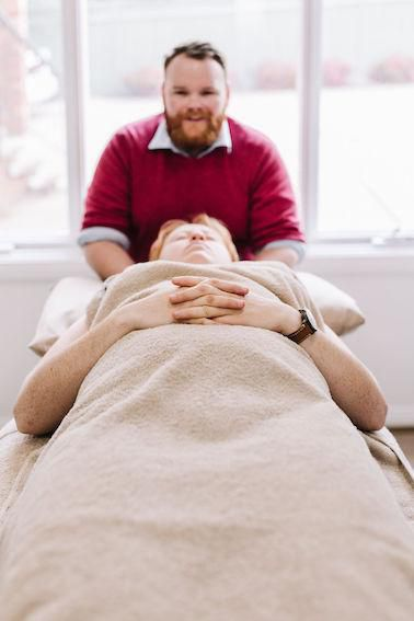 Tom working with a patient experiencing neck pain