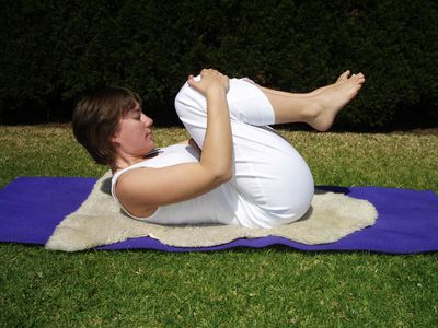 Kundalini Yoga posture — nose to knees, with breath of fire