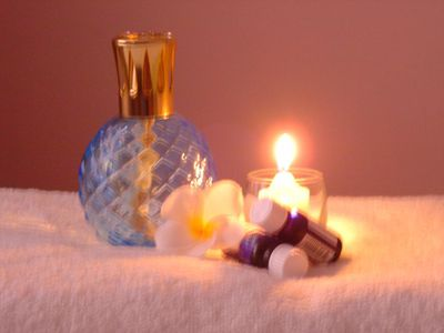 ionizing lamp with candle and essential oils